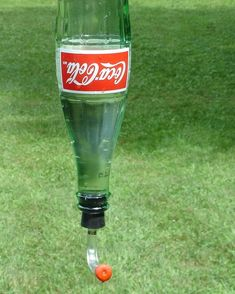 Coke Bottle Hummingbird Feeder.  Love this! DIY?