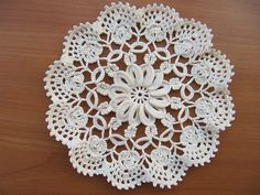 Lovely album of doilies, but no patterns.  Clover-Leaf Doily _Fig.23 by Priscilla Book _Centrepieces & Doilies