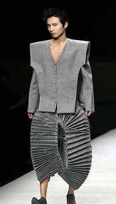 This exaggerates proportion with the 3D pleats and large angled top. Making it look sculpture like.