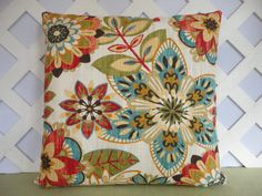 This colorful floral pillow cover would brighten any room. It includes colors of red orange teal blue green ivory. The fabric is a cotton home decor fabric and it is used on both sides of the 18 x 18 decorative pillow cover. Dry cleaning is recommended. There is a bottom zipper so that you may easily add or remove your pillow form.   I craft each pillow in a smoke free and pet free shop and use only top quality fabrics. Each seam is double stitched with a zigzag stitch for durability. If you…