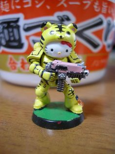 Hello Kitty Warhammer 40K -- If you can't outmaneuver your opponent, overwhelm them with cuteness. Or at least leave an adorable corpse, given the setting.