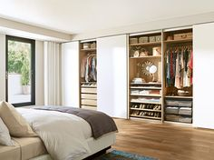 Picking your outfit from bed is within reach with PAX wardrobes and KOMPLEMENT interiors. IKEA