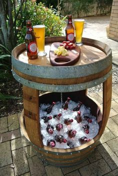 Patio beverage cooler/table made from old whiskey barrel.
