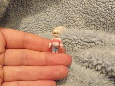 Karen Ferrier, Karen's Mini Bears - hand sculpted tiny doll with movable head wearing blue jeans and striped sweater. sold on ebay for £54 (approx $89)