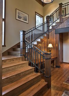 12th Avenue Iron: forged steel railing at entryway staircase