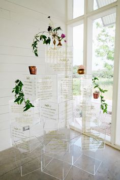 Creative wedding seating chart display on lucite/ acrylic cubes. Makes a huge visual impact on guests as they look for their table assignment at your wedding.