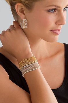"""""""Kinetic Hoops Cuff with Ball Beads"""" by Tana Acton, shown in a sterling wire cuff with 12kt gold-filled beads and a gold-filled wire cuff with sterling silver ball beads."""
