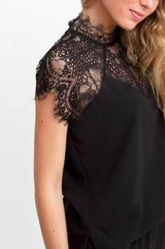 Get your chic on with this lovely black jumpsuit. Finished with beautiful unlined lace and features cut-out detailing at the waist. Add killer heels and you've got yourself the ultimate alternative to party dresses and separates. By Neo Noir.      Available at Sienna & Lois.