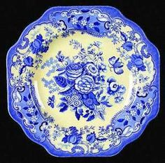 "Marked in blue on the underside ""Spode 2 attractive different floral designs. Glossy yellow with shades of blue and white flowers."