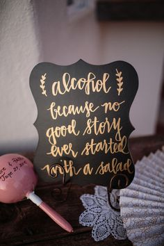 """Funny cocktail hour sign - chalkboard sign with gold calligraphy """"alcohol because no good story ever started with a salad"""" {Anna Gomes Photography}"""