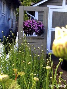 Repurposed Vintage Door Cleverly Hides Trash Cans Yellow Front Doors, Front Door Colors, Glass Door Hinges, Sliding Glass Door, Exterior Front Doors, Exterior Trim, Garden Yard Ideas, Patio Ideas, Outdoor Ideas