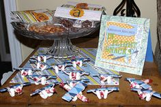 In-Flight snacks, peanuts and pretzels and planes made out of gum, smarties and lifesavers as favors