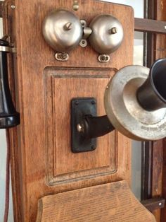 This S.H. Couch Company magneto wall type telephone is mounted inside an early 1900's antique phone booth used by Judge John Fox of Boston, MA. Apparently, the Judge was on the phone continuously. As a retirement gift, the Judge's clerks and others purchased the original phone and moved it to his home as a surprise gift.