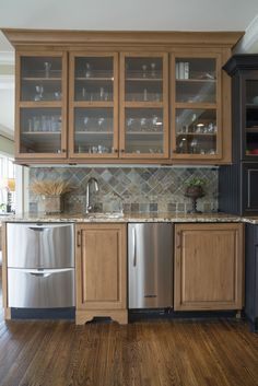 photo by Med Dement   #kitchen #wetbar #winefridge #granite #decor #homedecor #chattanooga #cha #kitchenisland #island #countertops #cabinets #pendantlights #appliances #rangehood #glasscabinetry