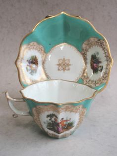 19th Meissen Porcelain Shaped Cup and Saucer Painted with Panel of Lovers