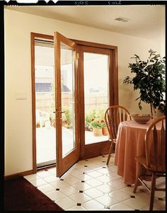 Pella Proline Energy Star Qualified Hinged Patio Doors Convey The Natural Warmth