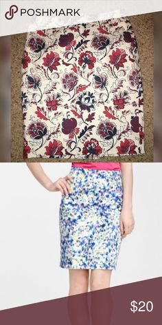Ann Taylor Printed Pencil Skirt Petite Size 0...NEVER WORN! Second picture is to show fit and length. Colors are cream, blue and red. Shell is 100% cotton. Lining is 100% polyester. Zipper closure in the back. Ann Taylor Skirts Pencil