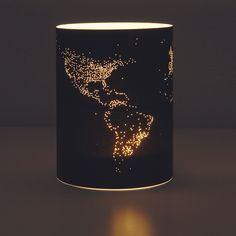 lights of earth, pin holes in paper??? taped then placed around a tea light…