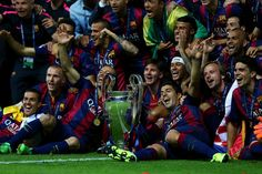 Barcelona players including Javier Mascherano, Lionel Messi, Neymar and Luis Suarez celebrate victory with the trophy after the UEFA Champions League Final between Juventus and FC Barcelona at Olympiastadion on June 6, 2015 in Berlin, Germany.