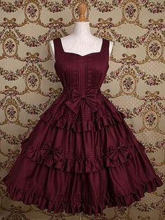 This is a nice fancy dress. It's got everything from pintucks to ruffles to tiers, with bows and a sweetheart neckline.