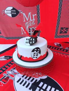 Red & Black Swazi traditional wedding cake at Shonga Events African Wedding Cakes, African Wedding Theme, African Wedding Attire, African Weddings, African Attire, African Wear, African Traditional Wedding Dress, Traditional Wedding Decor, Traditional Cakes