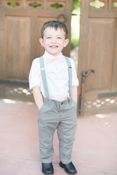 Light grey, navy, blush pink, white, and lavender color palette. Suspenders for the ring bearer.