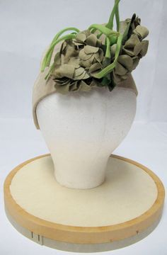 1940's Tan Grosgrain Fabric Hat with Green Silk Flowers. $30.00, via Etsy.