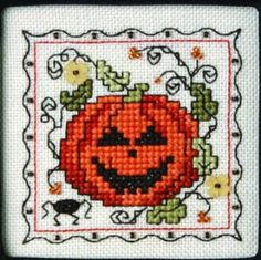 Teenie Tiny Halloween III with charms is the title of this cross stitch pattern from The Sweetheart Tree.