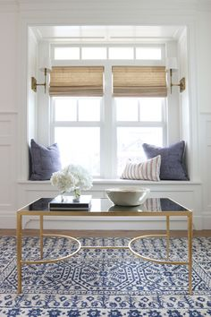 Window seat - love! Also the shades, sconces, and setup with coffee table & chairs on other side.  McGee Studio: Pacific Palisades project.