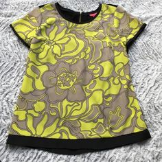 Gray and green short sleeve shirt Gray and green vibrant silk feel short sleeve shirt. Perfect for casual or even work super comfortable and flattering. Open to offers Sunny Leigh Tops Blouses