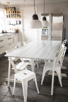DIY table in my scandinavian kitchen.  Tolix A chairs, Tolix Stool, Tripp Trapp Stokke, hay loop stand, House Doctor Factory lamps