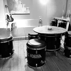 Some of our furniture at Y Lloft, music venue and bar in North Wales, UK.  Rock Terrace provided leather topped tom tom stools, wooden-topped bass drum tables and a snare and bass drum chandelier.  To discuss commissions and made-to-order pieces, call us on 01654 702463.  Follow us on Twitter and Instagram for more photos and info.