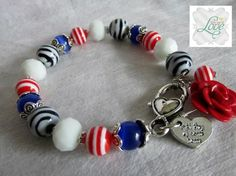 Military Themed Bracelet * 7 1/2 Inches long ( Size is Adjustable ) * All Glass Beads * Handmade Red Polymer Clay Rose