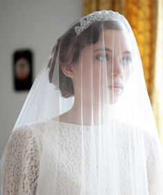 For the long veil bridal look I really do love how this one is held up by a silver and jewel encrusted pear shaped crown. However, when the veil comes off I'd prefer for the tiara to be removed as well.