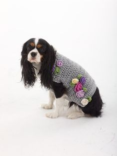 Embellish this dog sweater with crochet flowers for an adorably cute outfit. Crochet a matching hat for yourself for a matching set!