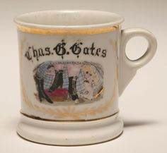 Occupational shaving mug, Ladies High Button Shoes with Cupids. Gilt trim. Good condition, minor wear.