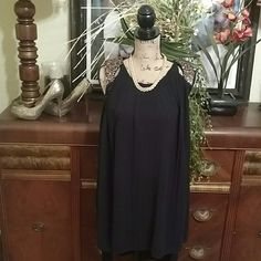 Lets Party High-low dress Little black number that will wow the crowd! Made of Polyester and Spandex. Gold shoulder pads that add that extra pop! tag says Medium but is probably a 6-8. Only worn once. Minor threading detachment on inside slip and shoulder pad which can easily be repaired. Worn only once. Good condition but selling As Is. GiGi Generation Dresses High Low
