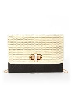 Check it out from Lulus.com! Ace the accessory game with the Top Perfor-Rated Black and Cream Clutch! Black, crinkled vegan leather clutch has a cream-colored top flap that's perforated for a cool, mesh look. Vegan leather-topped, golden twist lock opens to reveal a satin lining with three interior sections and a secure zippered pocket. 47
