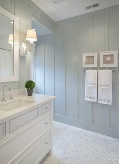 nice look for a beach house bathroom Love the rectangular sinks. I love the color of the walls.