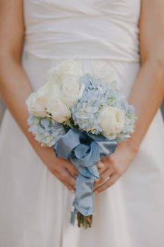 Pale blue hydrangeas, creamy white roses and the prettiest pale blue ribbon ~ so beautiful. Photography by yvonne-wong.com / Bouquet by Freesia Designs