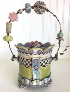 Handmade ceramic slab pottery trinket box/jar with wire and bead handle. Sgraffito checkerboard pattern wraparound. Glazes include Spectrum Bright Green, Amaco Celebration Turquoise, and Celebration Lilac.