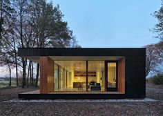 This glass and timber house by Dutch office DP6 Architectuurstudio has been…