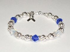 ALS Awareness Bracelet ~ Swarovski® Crystal & Sterling Silver (Twist) by Aqua Moon Keepsakes. We donate a portion of the proceeds of the sale of each awareness item to research for a cure. Amyotrophic Lateral Sclerosis, Keepsakes, Cancer Awareness, Keychains, Cure, Nursing, Swarovski Crystals, Aqua, Kiss