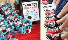 """favor basket filled with a """"Thanks, I had a ball!"""" treat bags filled with black gumballs, some pixie sticks, twizzlers, and a water bottle."""