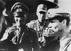 German military commander Erwin Rommel (1891 - 1944) drinks to victory at El Alamein in Egypt during World War II, 1942. This photograph was found on a captured German soldier.