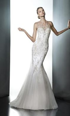 Pronovias Pleya 12  buy this dress for a fraction of the salon price on  PreOwnedWeddingDresses 4523da6297
