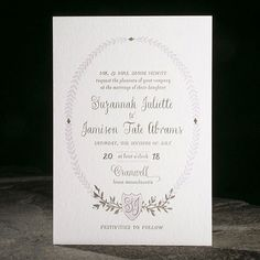 Lilac and taupe give this simple invitation a fresh feeling. A simple shield serves as the focal point and showcases the couple's new monogram./