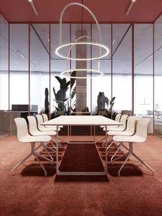 This commercial design and office space is unique with the modern lighting. The space also has a lot of natural lighting coming in through the tall windowed walls. Cool Office Space, Office Space Design, Workspace Design, Office Interior Design, Office Interiors, Office Designs, Office Spaces, Small Office, Design Commercial