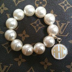 stretchy pearl bracelet with a clip on monogrammed charm :) cute and inexpensive