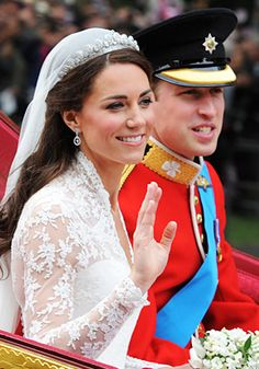Newlyweds Prince William and Kate Middleton on their way back to Buckingham Palace after their wedding, April 2011